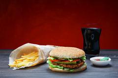 Fast food take away. Hamburger, cola and fries - stock photo