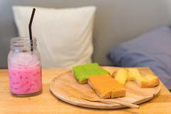 Sweet Bread toast and cold ice pink milk Stock Photos