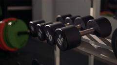Sports dumbbells rubber in modern sports club 4k Stock Footage