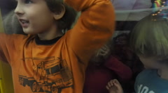Children Standing In Wind Tunnel Stock Footage