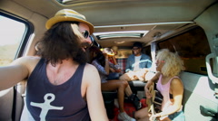 4K Happy hipster friends on summer road trip in camper van Stock Footage