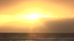 Sun Falls Behind Cloud Bank Over Ocean Timelapse Stock Footage