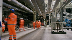 4K Time lapse of busy team of engineers working together inside power station Stock Footage
