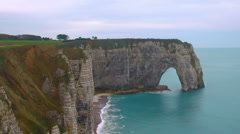 Natural stone arches, white chalk cliffs above English Channel, Etretat, France Stock Footage