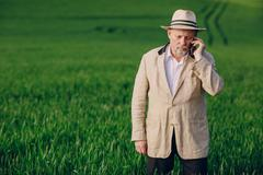 old man in field - stock photo