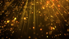 Lots of gold glitter particles falling in light rays loop 4k (4096x2304) Stock Footage