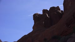 ARCHES NATIONAL PARK, contrail threading the needle Stock Footage