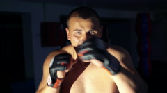 Close up boxer trains on punching bag- mannikin in the gym 4k - stock footage