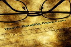 Health benefits claim form grunge concept - stock photo