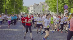 Marathon, people running in mass sport competition, slow motion. Stock Footage