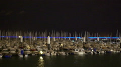 Yachts and small boats moored at marina, night view of vessels in large harbor Stock Footage