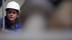 4K Close up portrait 2 female engineers in discussion in power plant Stock Footage