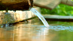 Clean, fresh, natural spring of drinking water with wooden channel Stock Footage