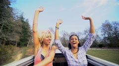 4K Friends driving to music festival, standing up through open roof in camper Stock Footage
