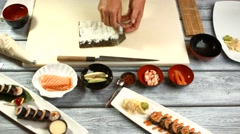 Male hands preparing sushi. Stock Footage