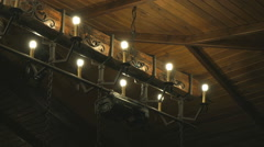 Wooden ceiling with lamps in the form of candles Stock Footage
