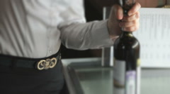 Hand opening the wine bottle using the corkscrew Stock Footage