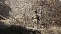 War in Afghanistan - United States Marine Sweeping for Land Mines in a field - stock footage