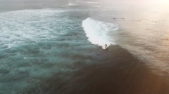 Aerial view of huge ocean waves and surfing in Bali indonesia - stock footage