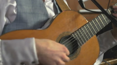 The man playing the guitar at the concert Stock Footage