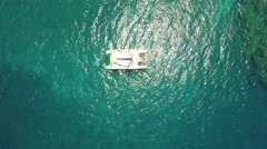 4K aerial view of diving tour boat and tilt up to horizon Stock Footage
