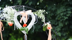 Wedding altar decorated with white,orange roses and heart made of cloth waving - stock footage
