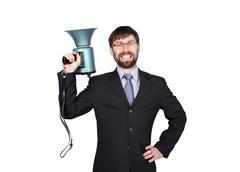 Bearded businessman yelling through bullhorn. Public Relations. man expresses Stock Photos