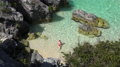Girl swims in the small pool of Jobson's Cove bay at Bermuda. Stock Footage