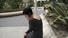 Young woman talking on the mobile phone outdoor Stock Footage