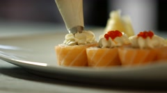 Tool decorating sushi rolls. Stock Footage