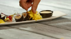 Yellow flowers on sushi plate. Stock Footage