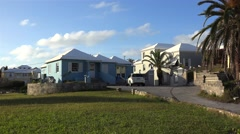 Typical Bermuda colourful houses with a white roof to collect rainwater. - stock footage
