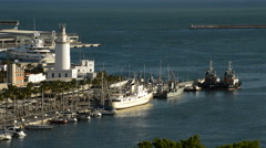 Sport port, docks and Lighthouse in Malaga port, Spain Stock Footage