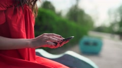 woman in red dress holding a phone with app mobile wallet - stock footage