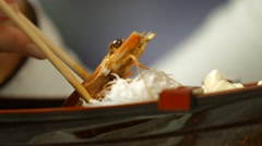 Hand with chopsticks taking shrimp. - stock footage