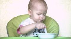 Baby bangs spoon on plate 4k UHD (3840x2160) Stock Footage