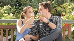 Couple toast wine to celebrate getting engaged and special moment Stock Footage