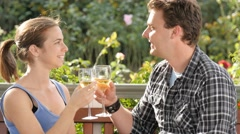 Young couple celebrate engagement with toast drinking wine sharing glass - stock footage