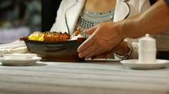 Woman with chopsticks eating sushi. Stock Footage
