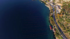 Aerial shoot of plantation for growing shells, mussels and oyster in the sea - stock footage