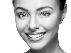 Close up portrait of beautiful young happy smiling woman. - stock photo