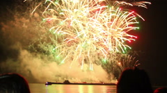 People watching epic fireworks at beach Stock Footage