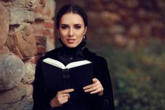 Beautiful Dark Princess Reading a Book Stock Photos