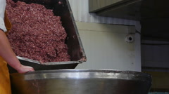 Meat chopper machine, mixing meat and spices for making hot dogs and sausages in - stock footage