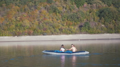 Family water tourists traveling on the river Dniester. The picturesque beach Stock Footage