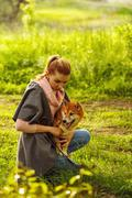 Shiba Inu puppy and girl in park. Stock Photos