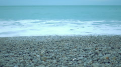 Endless ocean, foamy waves washing up on clean pebble beach, nature conservation Stock Footage