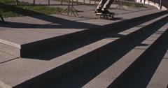 Skateboarder does flip, nice weather Stock Footage