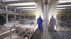 4K Interior view of huge industrial power plant & smiling female engineer - stock footage