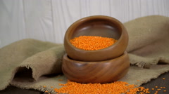 Red Lentils In A Wooden Bowl On The Table Stock Footage